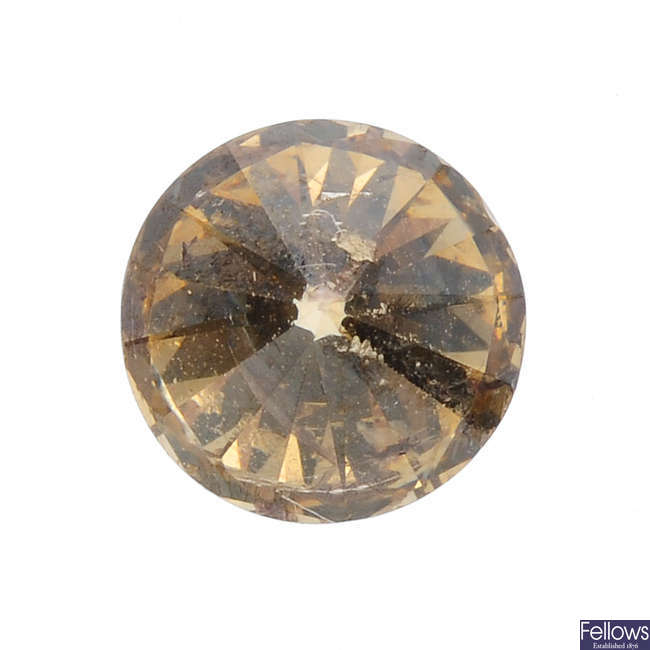 A brilliant-cut colour treated 'yellow' diamond, weighing 1.01cts.