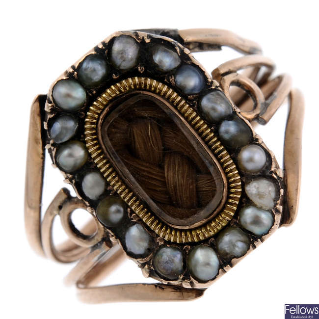 A mid Victorian gold split pearl memorial ring.