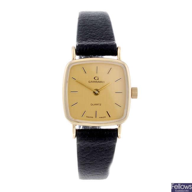 GARRARD - a lady's 9ct yellow gold wrist watch.