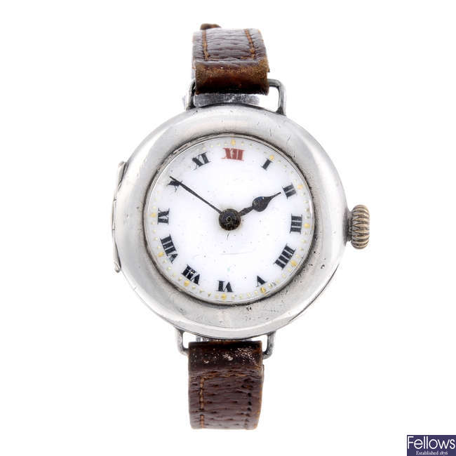 ROLEX - a silver trench style wrist watch.