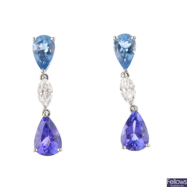 A pair of tanzanite, diamond and topaz earrings.