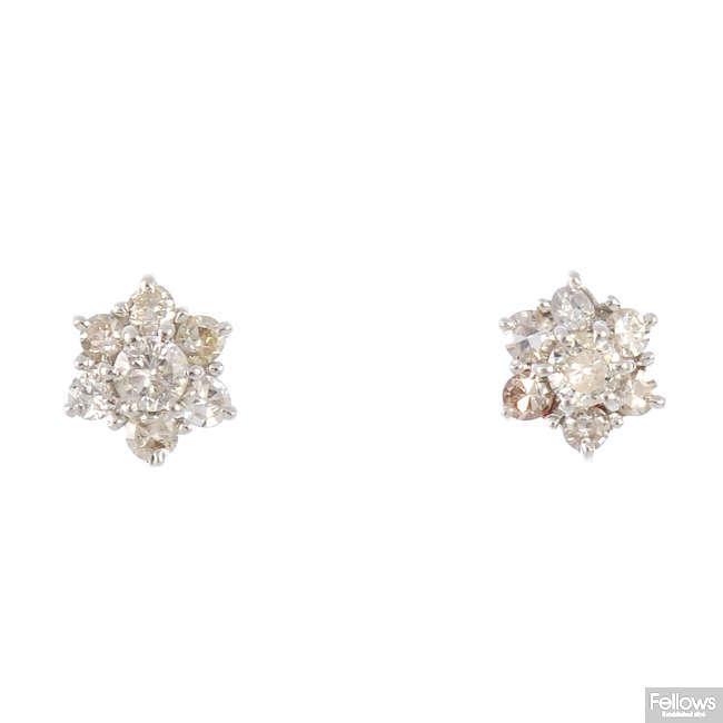 A pair of 18ct diamond cluster earrings.