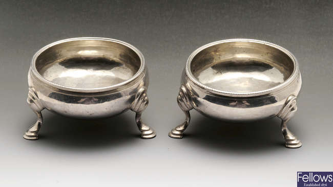 A pair of early George III silver cauldron salts.