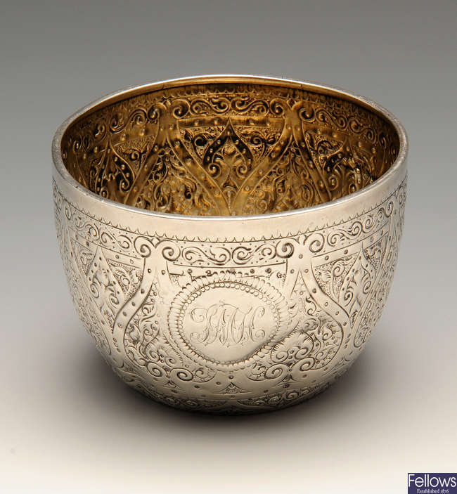 A late Victorian silver bowl with chased decoration.