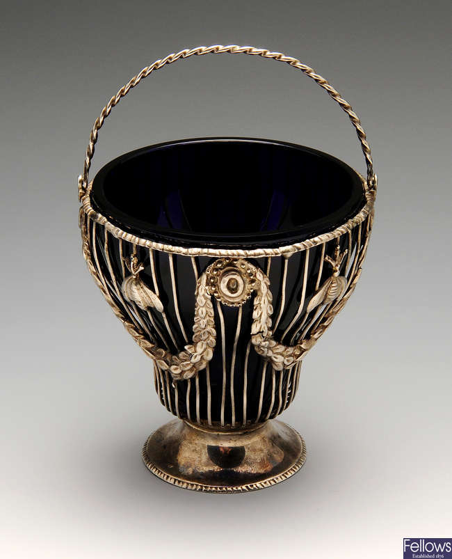 A George III silver pierced basket with swing handle & glass liner.