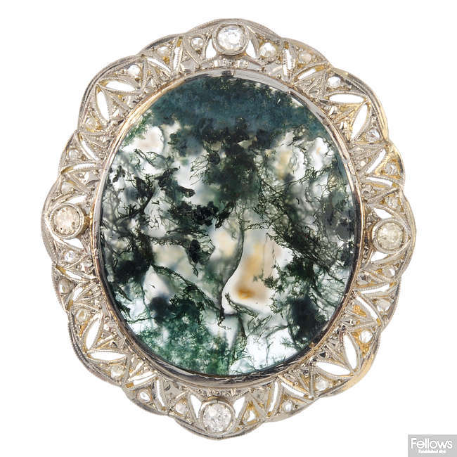 A moss agate and diamond brooch.