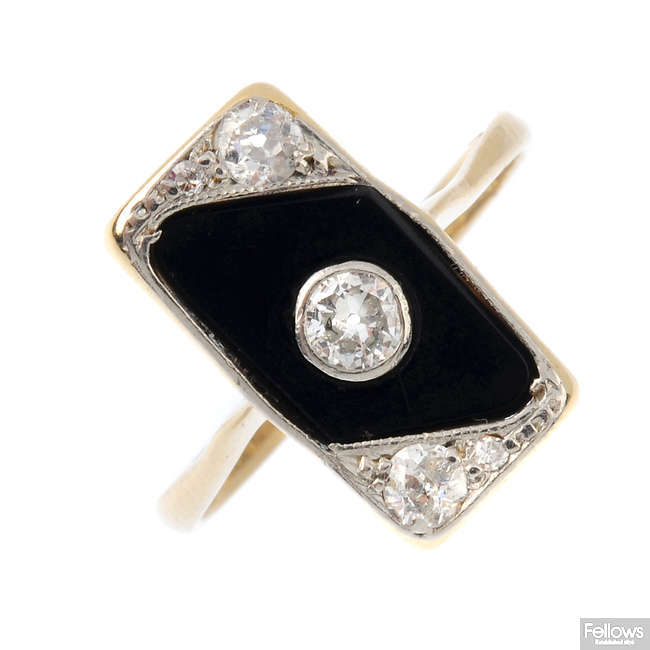 An Art Deco 18ct gold and platinum diamond and onyx ring.