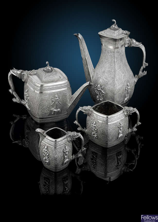 A Victorian silver four piece tea set in Indian style.