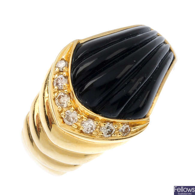 An onyx and diamond dress ring.