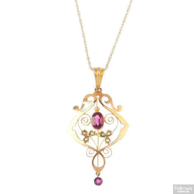 An early 20th century 9ct gold garnet and split pearl pendant, with chain.