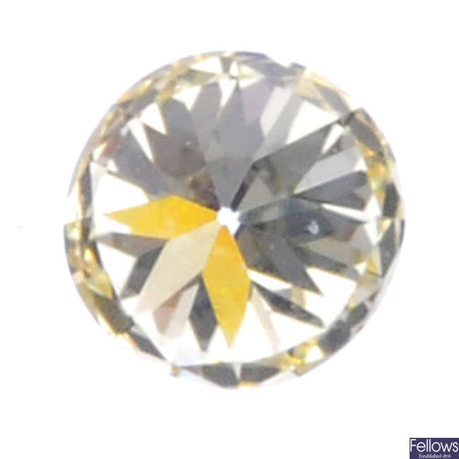 A brilliant-cut diamond, weighing 0.72ct.