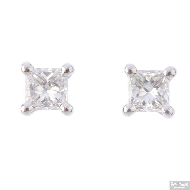 A pair of 18ct gold square-shape diamond single-stone stud earrings.