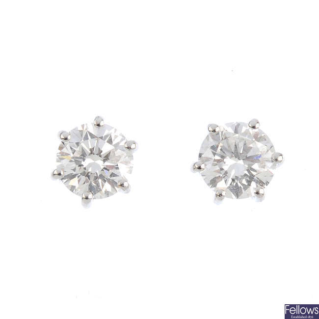 A pair of brilliant-cut diamond stud earrings.