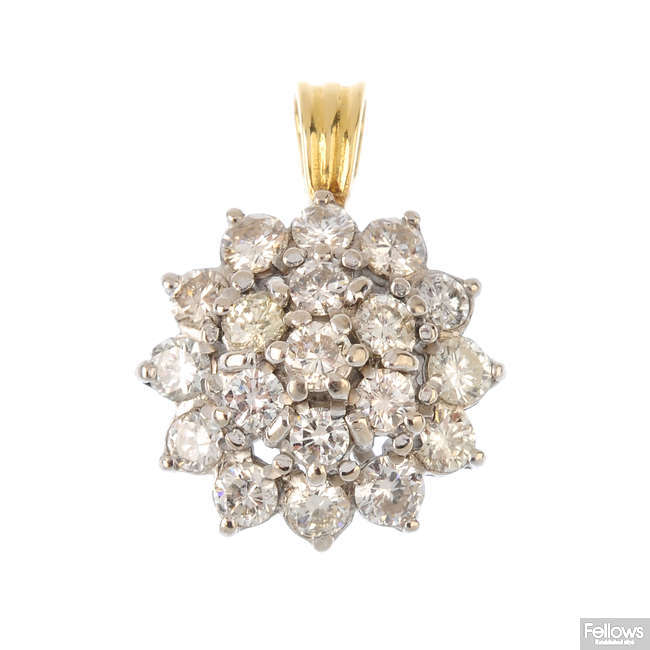 An 18ct gold diamond cluster pendant.