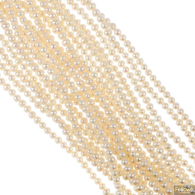 Twenty three cultured pearl single strands.