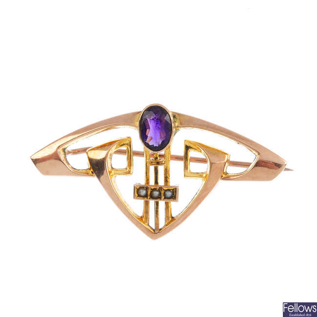 An Art Nouveau 9ct gold amethyst and split pearl brooch.