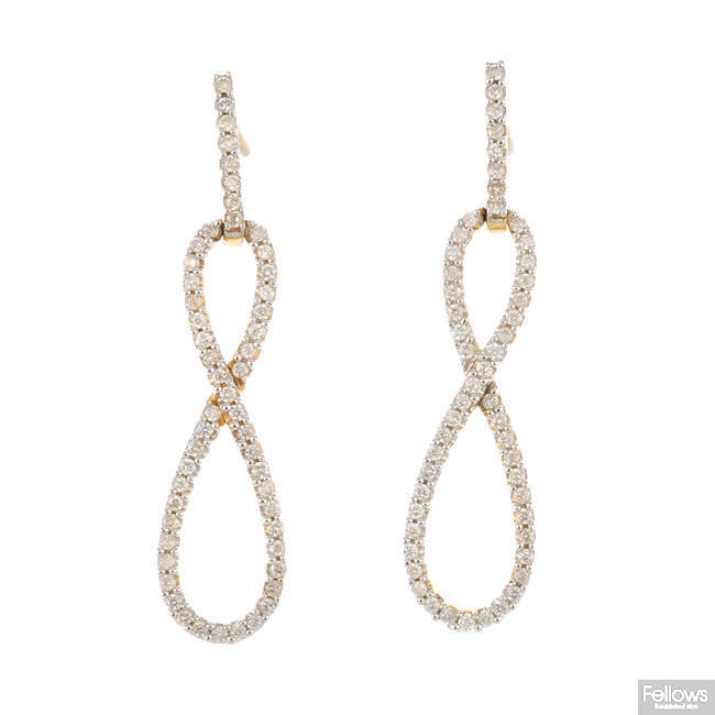 A pair of 14ct gold diamond earrings.
