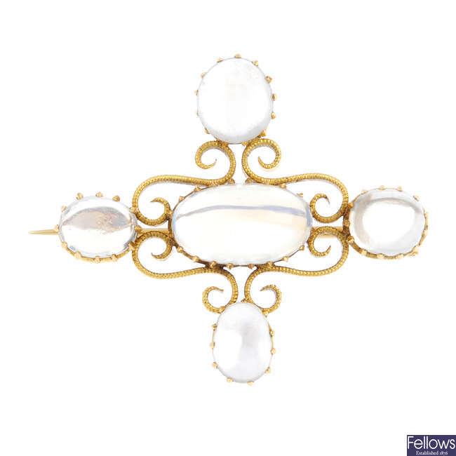 A late Victorian gold moonstone brooch, by Mrs Newman.