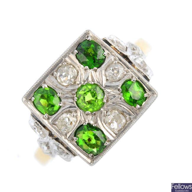 A demantoid garnet and diamond ring.