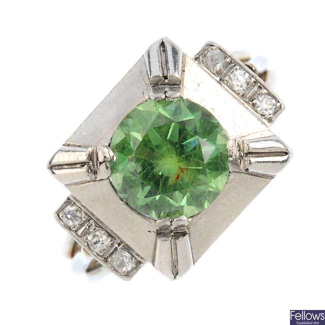 A demantoid garnet and diamond dress ring.