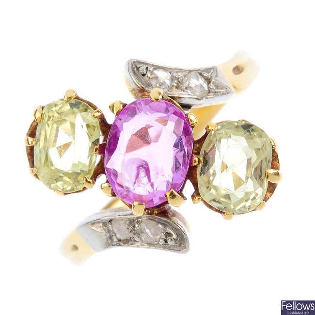 A sapphire and chrysoberyl three-stone ring.