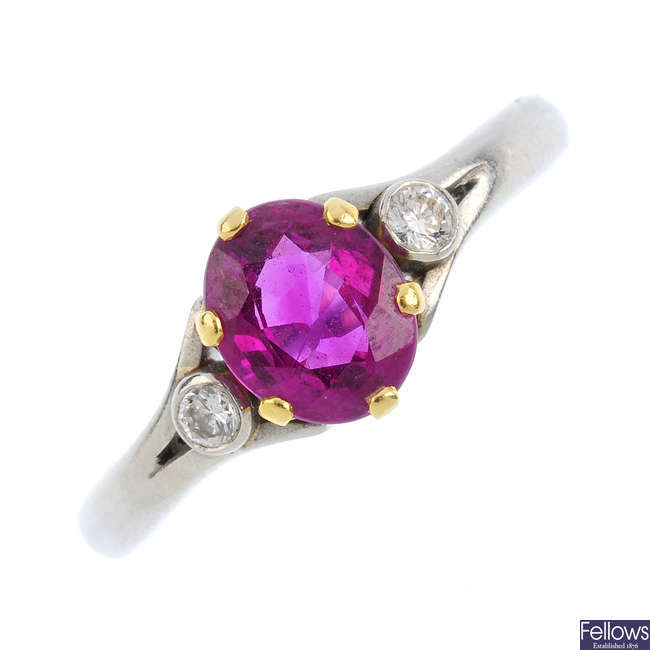 A platinum ruby and diamond ring.