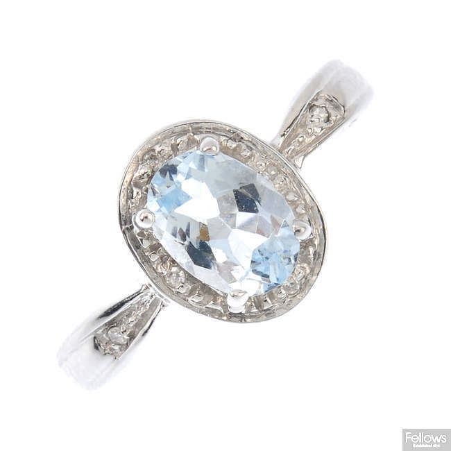 A 9ct gold aquamarine and diamond cluster ring.