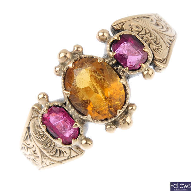 A late Victorian citrine and garnet-topped-doublet three-stone ring.