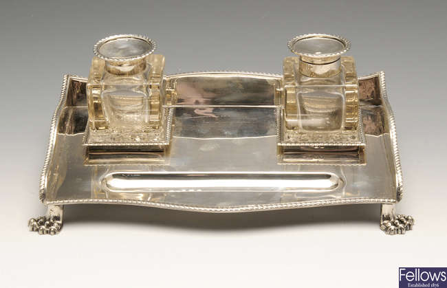 An early twentieth century silver desk inkstand of oblong form.