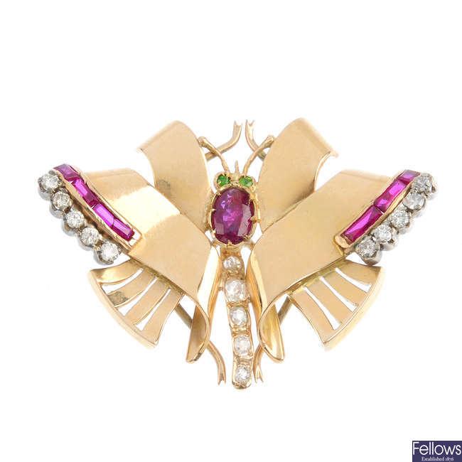 A mid 20th century ruby, synthetic ruby, diamond and demantoid garnet butterfly brooch.