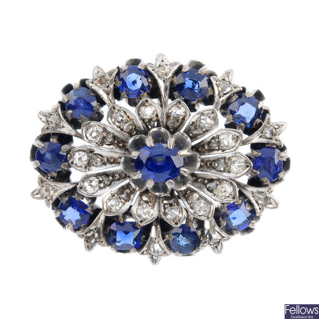 A late 19th century silver and 9ct gold sapphire and diamond cluster brooch.