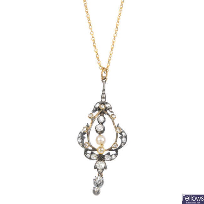 A late Victorian silver and gold diamond and cultured pearl pendant.