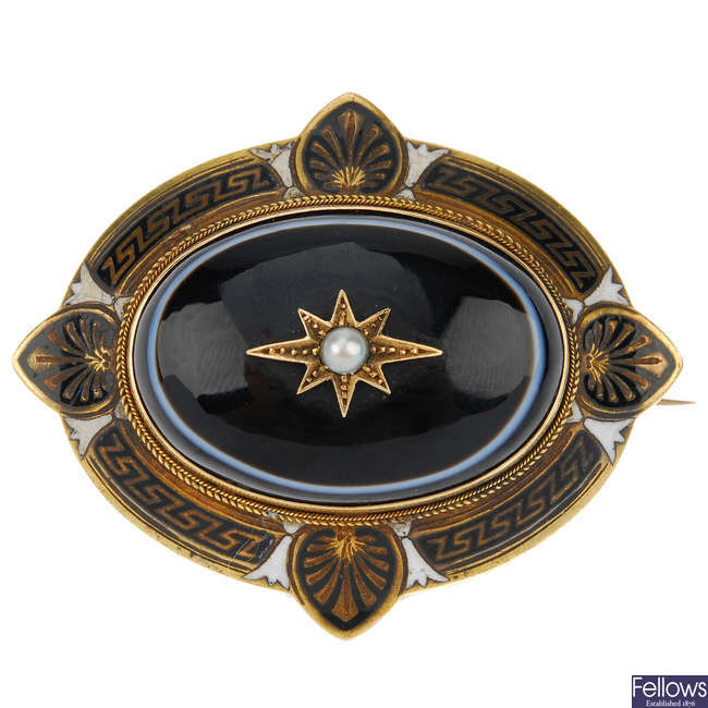A late Victorian banded agate, enamel and pearl mourning brooch.