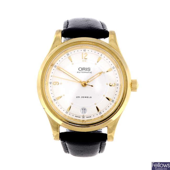 ORIS - a gentleman's gold plated wrist watch together with a lady's Rado eSenza wrist watch.