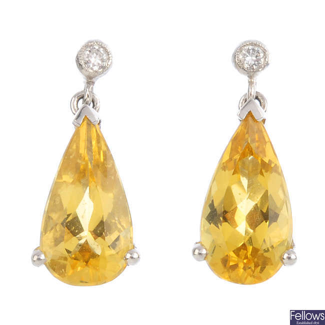 A pair of 18ct gold heliodor and diamond earrings.