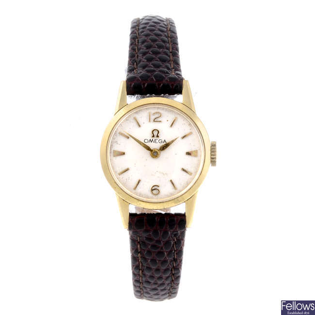 OMEGA - a lady's yellow metal wrist watch together with two yellow gold wrist watches.