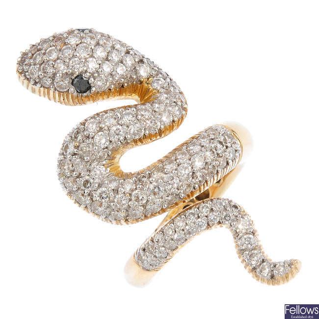A diamond and black-gem snake ring.
