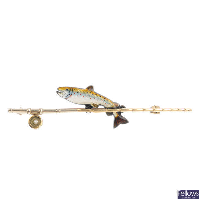 An enamel fish and rod novelty bar brooch, of fishing interest.