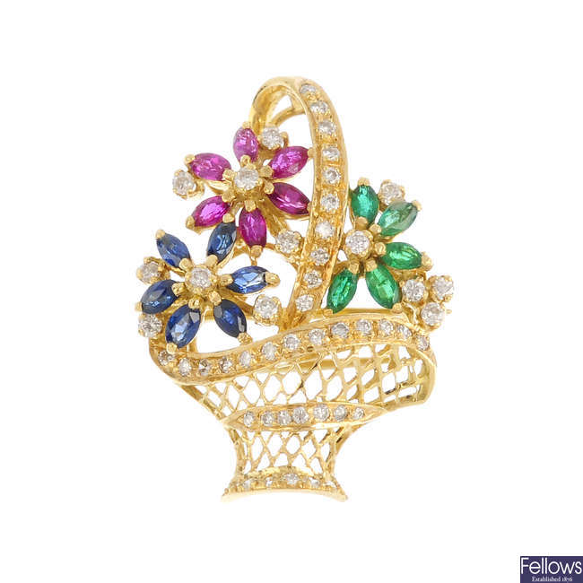 An 18ct gold diamond and gem-set brooch.