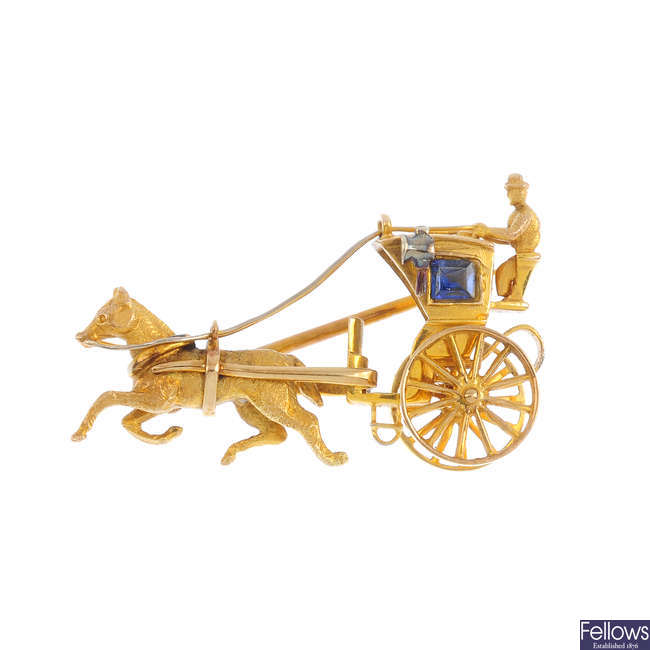 A 9ct gold and sapphire horse and carriage brooch. Alabaster & Wilson