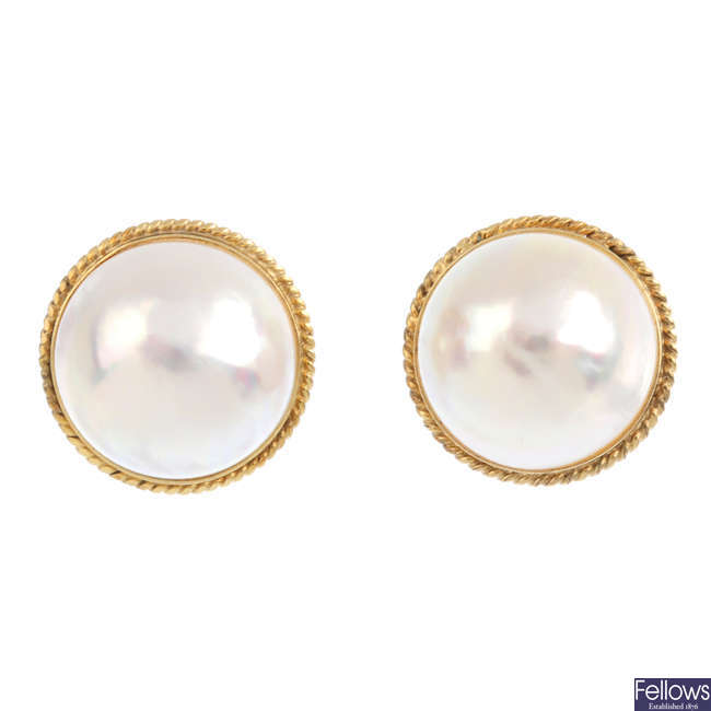 A pair of 9ct gold mabe pearl earrings.