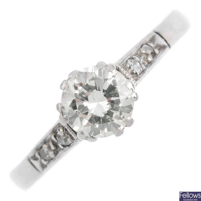 An 18ct gold and platinum diamond single-stone ring.