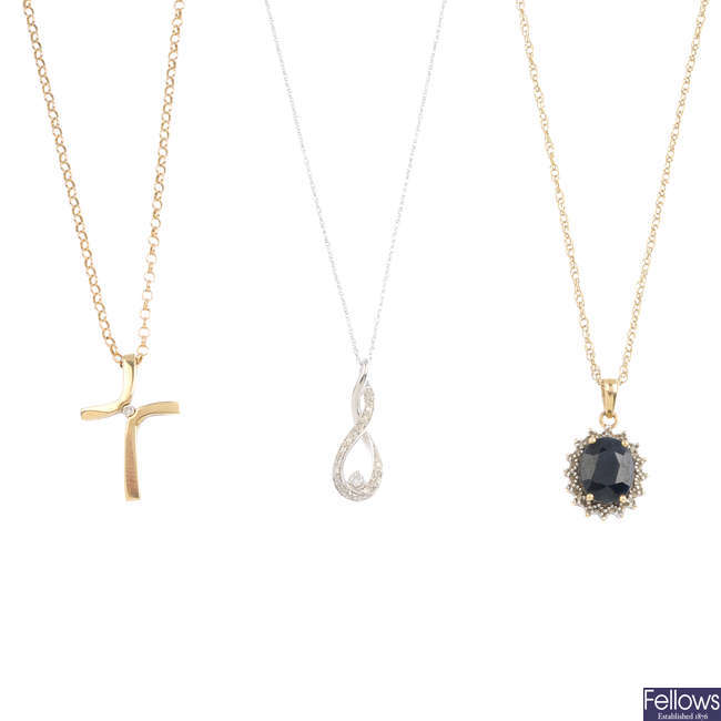 A selection of gem-set pendants, with three chains.