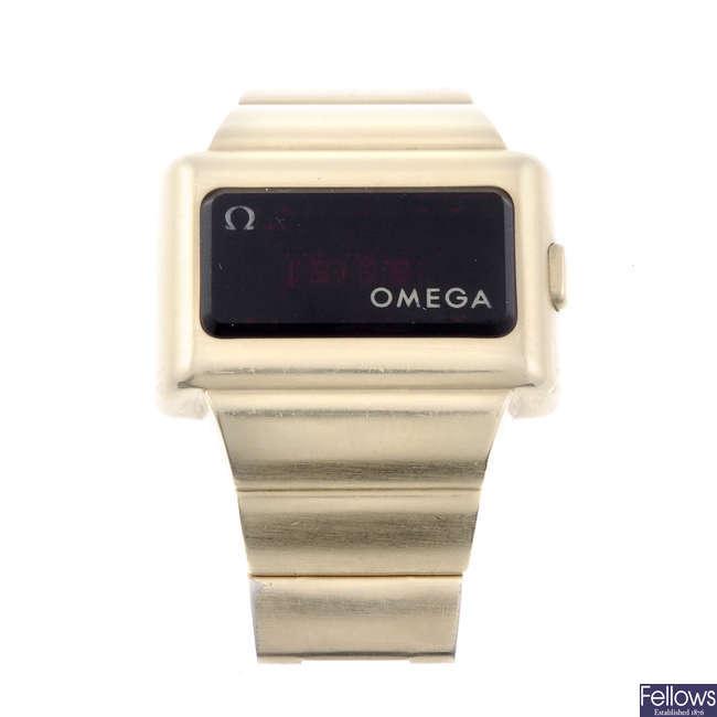 OMEGA - a gentleman's gold plated digital bracelet watch.