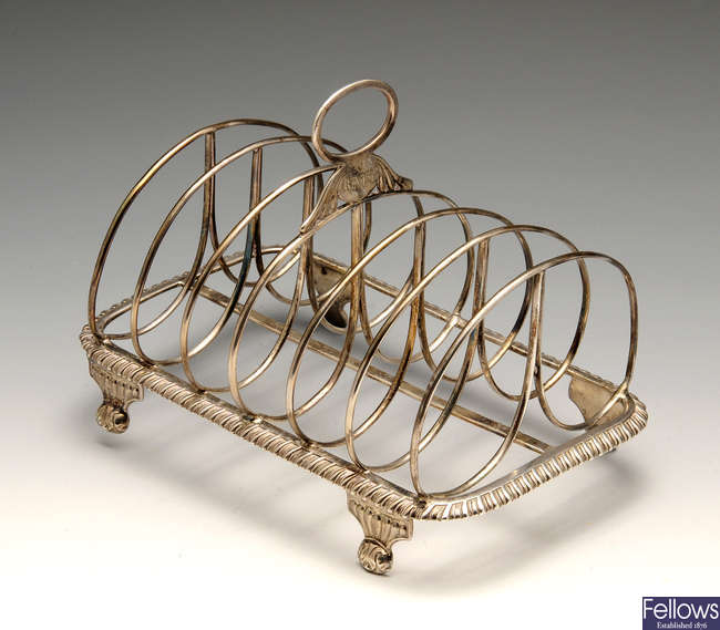 A George IV silver six-divide toast rack.