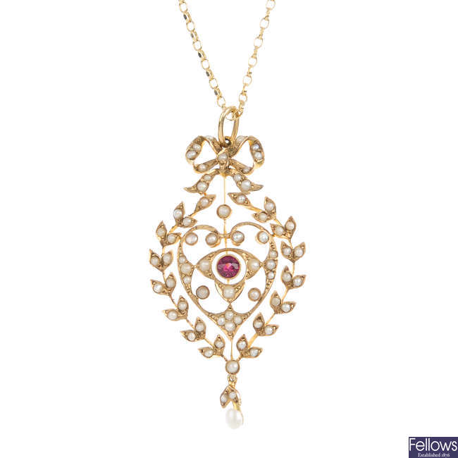 An Edwardian 9ct gold split pearl and garnet pendant, with later chain.