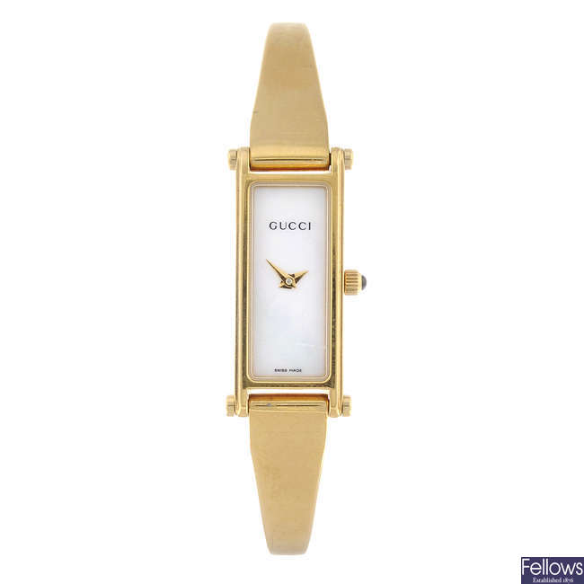 GUCCI - a lady's gold plated 1500L bracelet watch.