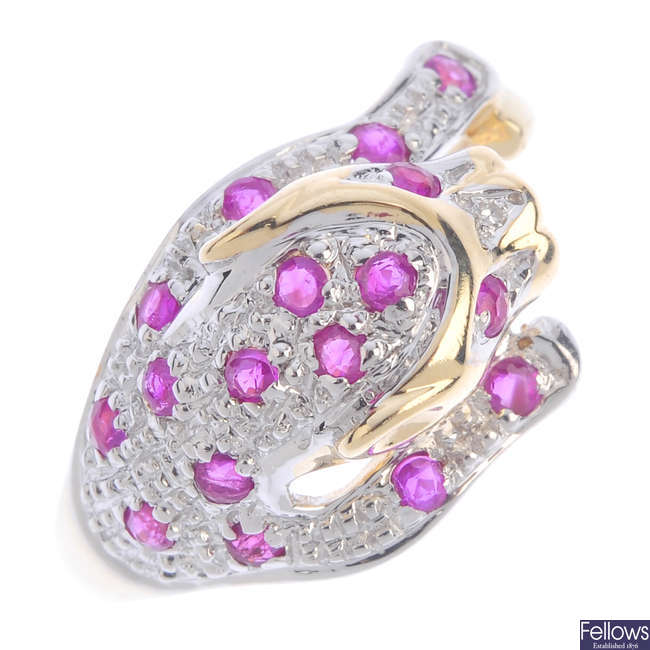 A ruby leopard ring.