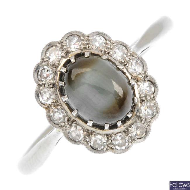 A cat's-eye chrysoberyl and diamond cluster ring.