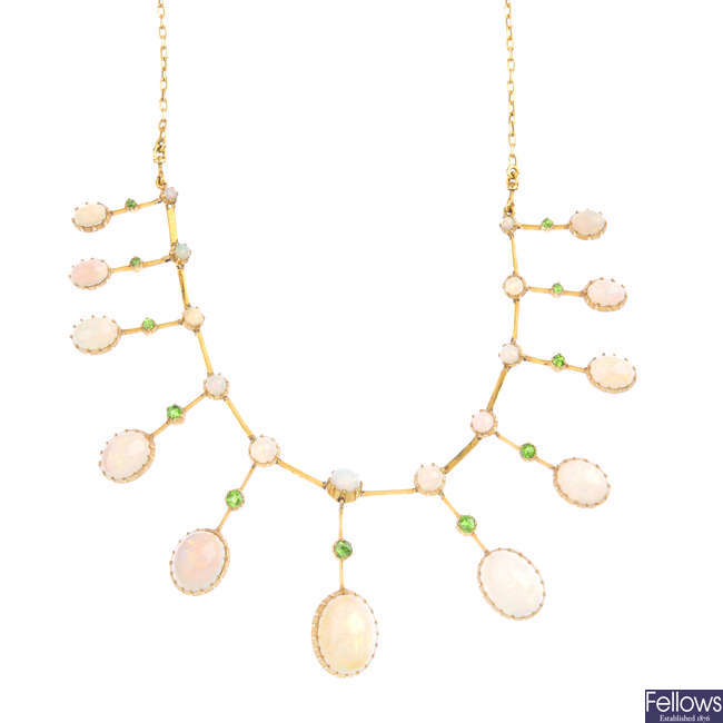 An early 20th century gold, opal and demantoid garnet fringe necklace.